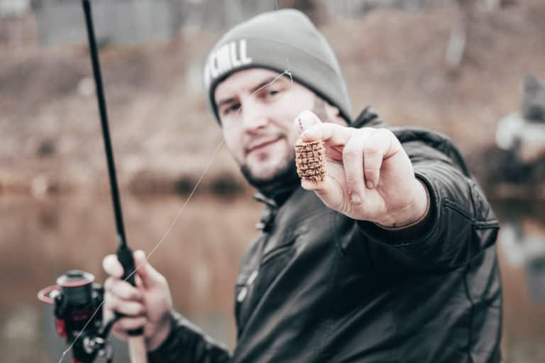 man holing fishing rod
